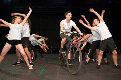 UK - Hull - Director Jamie Beale directs drama students from Hull University during a cycling sequence for an upcoming production of Cycle Song in the Gulbenkian Theatre.
