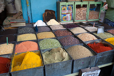Grains, spice, legumes, and dried fruits for sale at a market in Jodhpur, Rajasthan, India