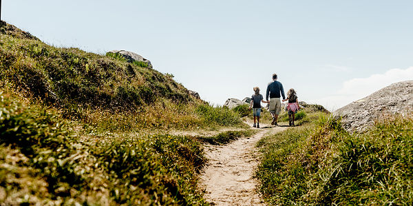 Father and two children walking on Hammerknuden on Bornholm, Denmark 3