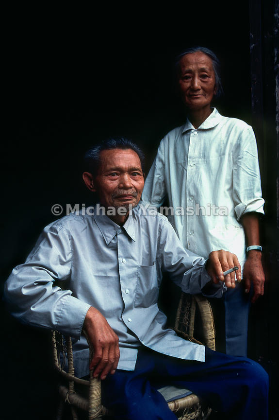 Veteran.Wan Shao Lian Age 75 and his wife pose for a portait. Ta Ping Do, China.