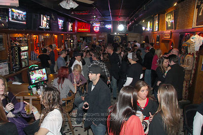 Patrons fill the bar at the Sports Column, 12 S. Dubuque Street, in downtown Iowa City Saturday night. Copyright Justin Torner 2012, http://justintorner.photoshelter.com