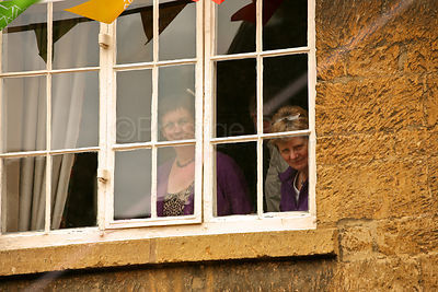 Spectators Watching Torch Relay Through Window