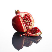 (RM) Pomegranate opened up on reflective surface (RM)