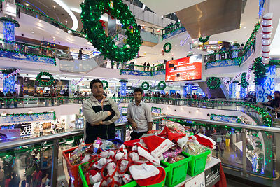 Workers sell Santa hats in South City Mall, Kolkata, India. South City is the largest mall in East India. Christmas is celebrated enthusiastically in Kolkata.