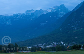 Bovec town beneath Kanin mountain range at dusk