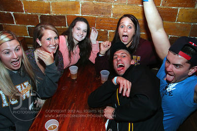 Patrons pose for the camera at the Sports Column, 12 S. Dubuque Street, in downtown Iowa City Saturday night. Copyright Justin Torner 2012, http://justintorner.photoshelter.com