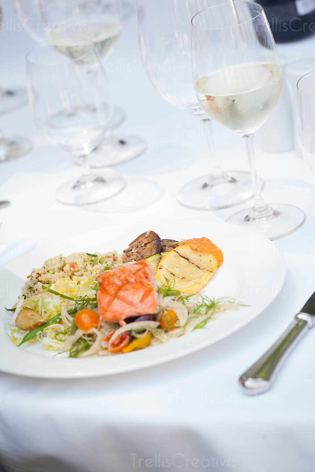 Delicious food with white wine on table