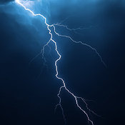 Lightning strike with dramatic blue cloudscape