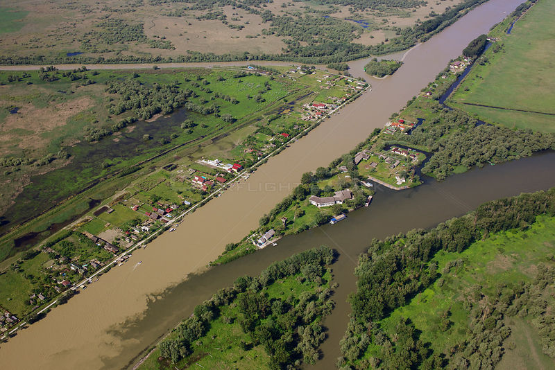 Aerial view of Crisan village, Bratul Sulina (Sulina Channel) Danube Delta Biosphere Reserve UNESCO World Heritage Site, Romania, May 2014.