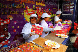 Doña Maria Luisa and her stall selling turrón during Señor de los Milagros festival, Lima, Peru