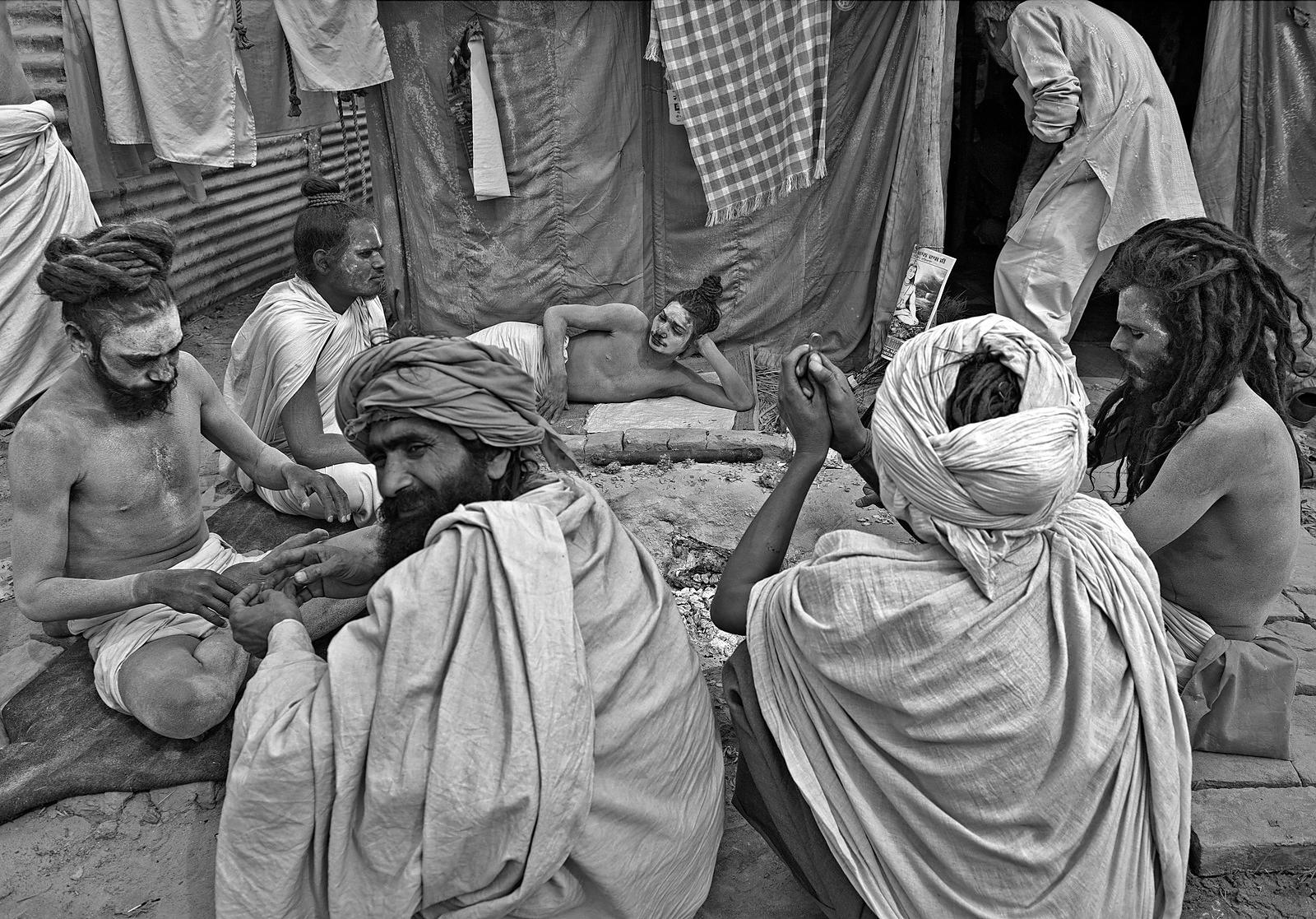 This group portrait of the saints resting, was shot at the kumbh mela, Allahabad