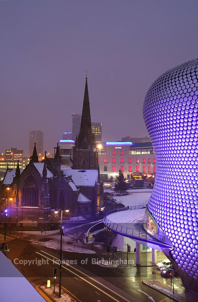 The Selfridges building at the Bullring Shopping centre in Digbeth, Birmingham city centre, during a snow storm. St Martins Church is in the background.