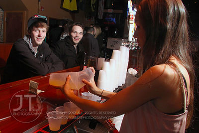 Bartender Gen Coulson attends to bar patrons the Airliner Bar, 22 S Clinton Street in downtown Iowa City Saturday night. Copyright Justin Torner 2012 http://justintorner.photoshelter.com