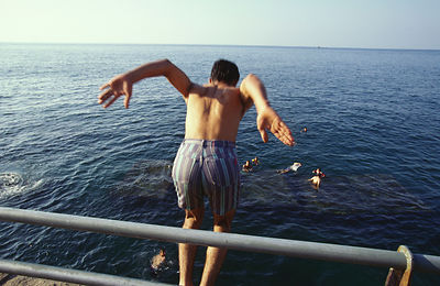 A boy jumps from the Corniche into the sea, Beirut