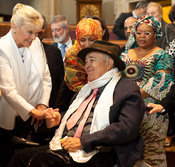 14th World Summit of Nobel Peace Laureates closing ceremony at the City Hall in Rome. Film Director Bernardo Bertolucci is congratulated by Betty Williams.