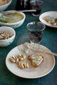 Rosemary Gorgonzola Pesto served with walnuts, crostini and red wine.