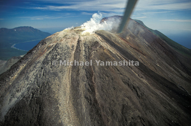 Above politics (and below the photographer's helicopter) Kudryavyy volcano sends out signals proclaiming true wilderness 3,235 feet high on Iturup.