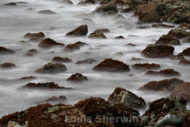 Waves washing over the rocky shore
