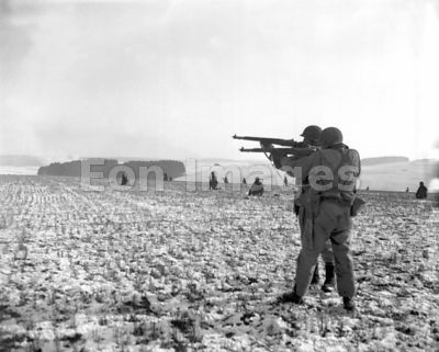 US infantrymen fire on Germans near Bastogne in Belgium