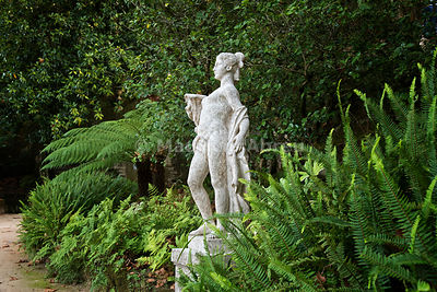 Classical statues in the luxuriant park of Quinta da Regaleira. Sintra, Portugal