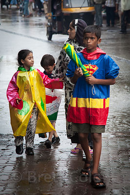 A boy in a Superman raincoat during monsoon rains in Bandra East, Mumbai, India.