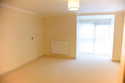 Empty carpeted apartment room