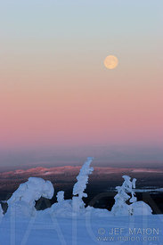 Full moon over frozen wilderness