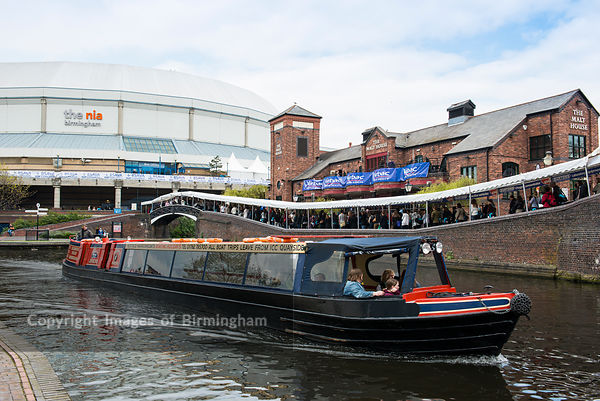 A canal barge passes the National Indoor Arena during a conference at the venue.