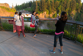 Tourists take photographs at the Snoqualmie Falls in Snoqualmie Falls Park near Seattle, Washington.