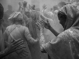 This photograph of the widows of Vrindavan playing holi was shot at the Gopinath temple.