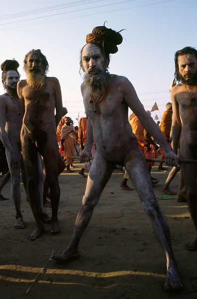 an ash smeared saddhu performs a mortification with his penis at the Ardh Kumbh Mela 1995, Allahbad, India