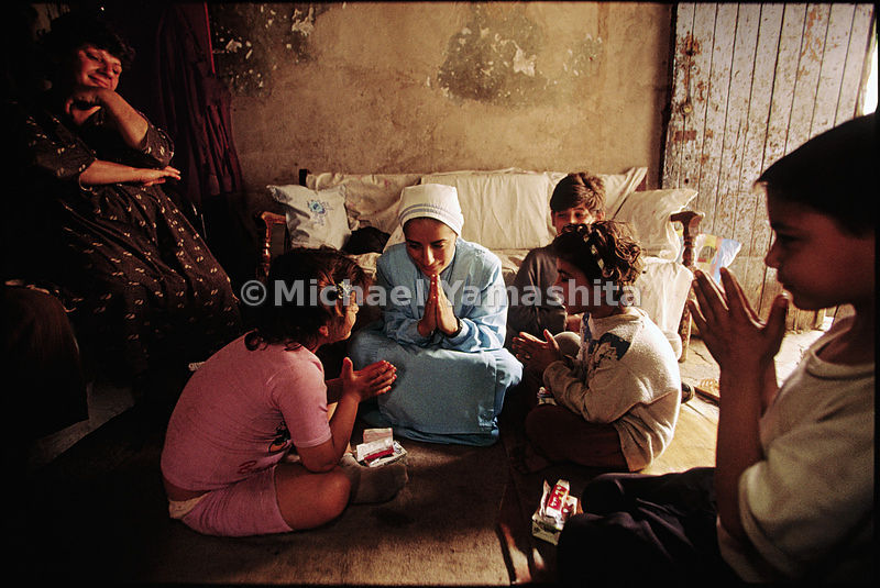Christian children pray in a home for impoverished families in Baghdad, Iraq.