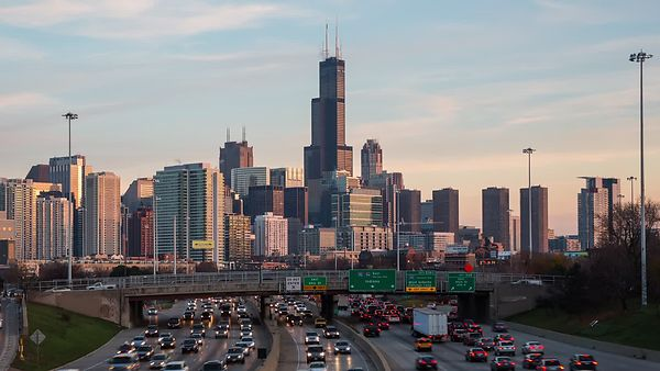 Medium Shot: Rush Hour, Pastel Clouds, & Sunset Over Chicago's Skyline (Day To Night)