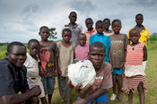 Childrens football team posing with a ball made of plastic bags. Rural Kenya.