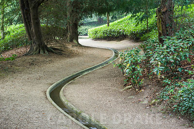 Rill leading along the Watery Walk between laurel hedges. Rousham House, Bicester, Oxon, UK