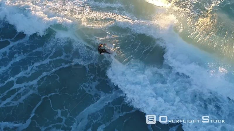 Surfers riding big waves in Perth Australia