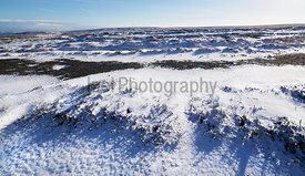 Snow drifts on the remote moorland of Edmondbyers Common in winter. England, UK.