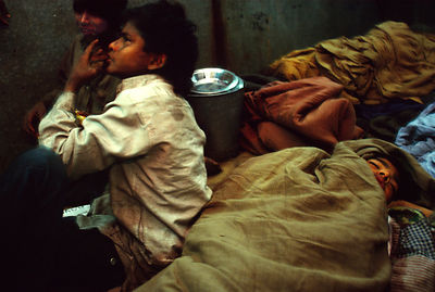 India - Delhi - Children ready to sleep in a dormitary at a night shelter