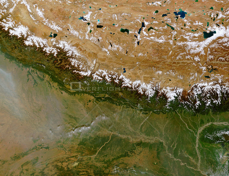 EARTH Great Himalayan Range -- 27 Oct 2002 -- The Himalayan Mountain Range runs a curving path from west to east in this true-color Terra MODIS image.