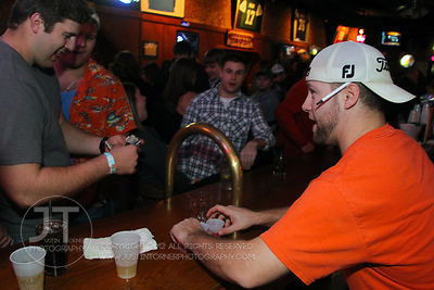 Patrons order at the bar at the Sports Column, 12 S. Dubuque Street, in downtown Iowa City Saturday night. Copyright Justin Torner 2012, http://justintorner.photoshelter.com