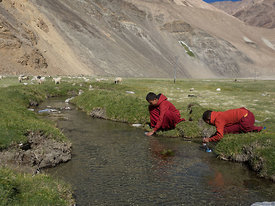 This photograph of young buddhist monks filling their water bottles was taken in Ladakh.