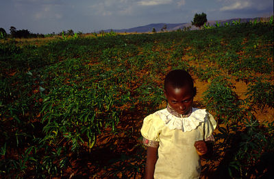 Burundi - Ruyigi - An orphan girl in her best dress, leaves her house