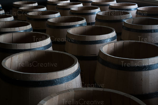Close-up of wooden wine barrels in a storage facility