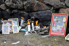 Candles and Señor de Qoyllur Riti picture outside Sanctuary, Qoyllur Riti festival, Peru