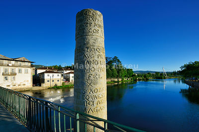 A pillar with roman inscriptions on the roman bridge of Chaves, also known as Trajan bridge, dating back to the 1st century AD. Trás-os-Montes, Portugal