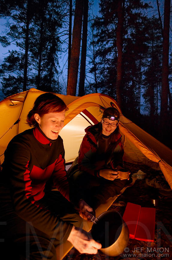 Women in tent at dusk