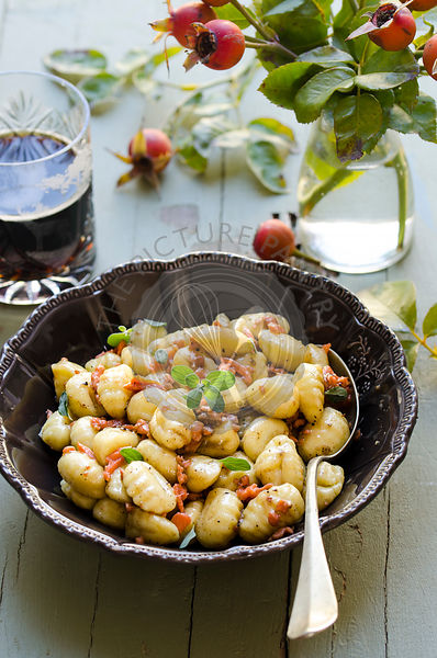 Potato gnocchi with salmon, butter and dark beer sauce