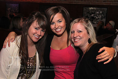 Bar patrons pose for the camera at the Airliner Bar, 22 S Clinton Street in downtown Iowa City Saturday night. Copyright Justin Torner 2012 http://justintorner.photoshelter.com