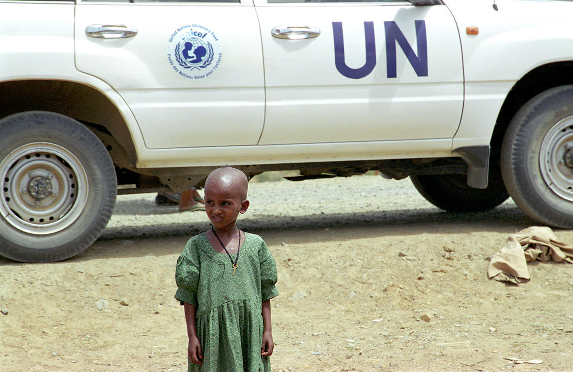 Tigray girl and UN car