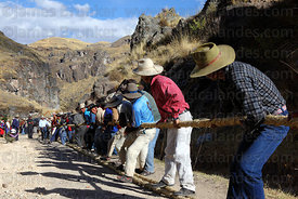 Tug of war contest to straighten and tension the thicker ropes for rebuilding the bridge, Q'eswachaka , Canas province , Peru